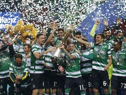 Sporting Lisbon players celebrate winning the Taca da Liga with the trophy on January 23, 2021