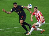 Watford's Troy Deeney in action with Stoke City's Nathan Collins in the Championship on January 22, 2021