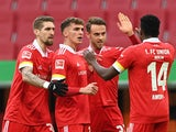 FC Union Berlin's Marcus Ingvartsen celebrates scoring their first goal with teammates on January 23, 2021