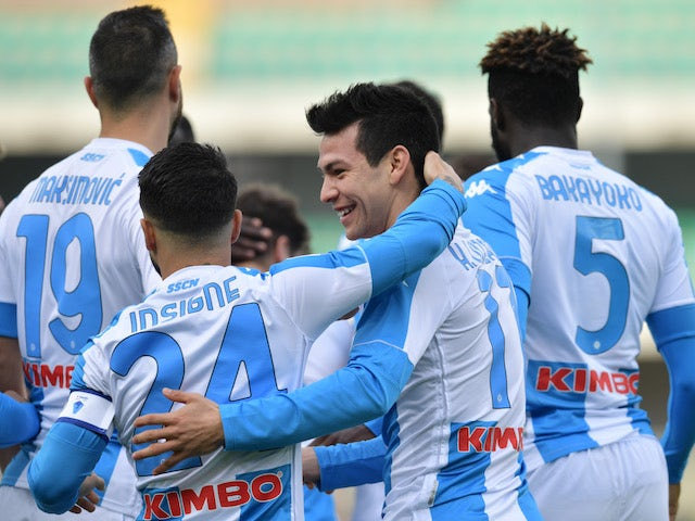 Napoli's Hirving Lozano celebrates scoring their first goal with teammates on January 24, 2021