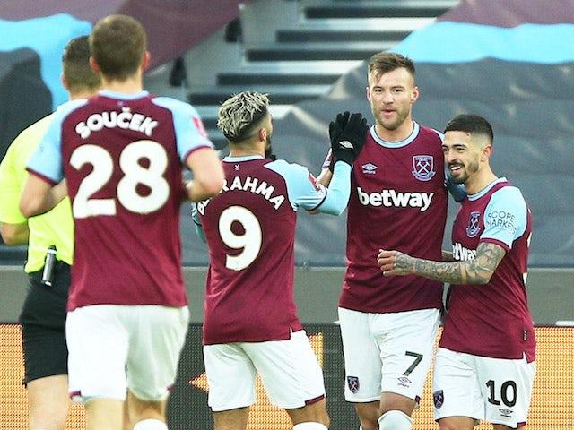 West Ham United's Andriy Yarmolenko celebrates scoring their second goal with teammates on January 23, 2021