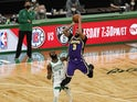 Los Angeles Lakers forward Anthony Davis shoots over Boston Celtics guard Jaylen Brown on January 30, 2021