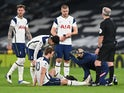 Tottenham Hotspur striker Harry Kane receives treatment for an injury suffered in January 2021
