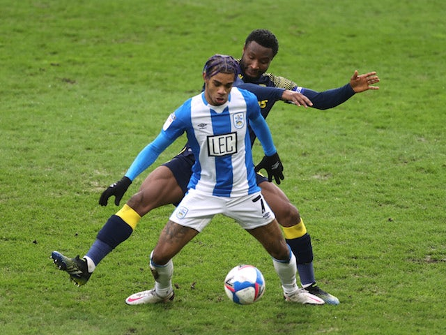 Huddersfield Town's Juninho Bacuna in action with Stoke City's John Obi Mikel on January 30, 2021