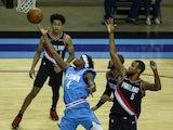 Houston Rockets forward Danuel House Jr. (4) shoots the ball as Portland Trail Blazers guard Rodney Hood defends on January 29, 2021
