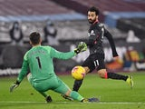 Liverpool's Mohamed Salah scores against West Ham United in the Premier League on January 31, 2021