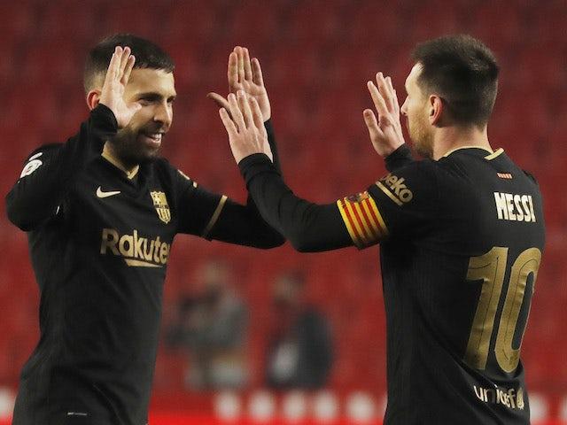 Barcelona's Jordi Alba celebrates with Lionel Messi after the Copa del Rey clash with Granada on February 3, 2021