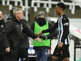 Newcastle United's Joe Willock pictured with manager Steve Bruce on February 6, 2021