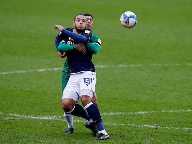 Millwall's Kenneth Zohore in action with Sheffield Wednesday's Liam Palmer on February 6, 2021