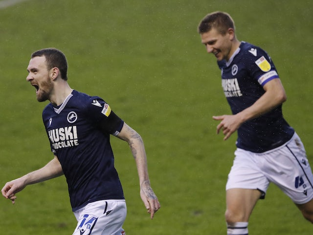 Millwall's Scott Malone celebrates scoring their second goal on February 6, 2021