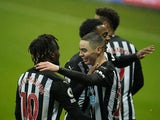 Newcastle United's Miguel Almiron celebrates scoring their third goal with teammate Allan Saint-Maximin on February 6, 2021