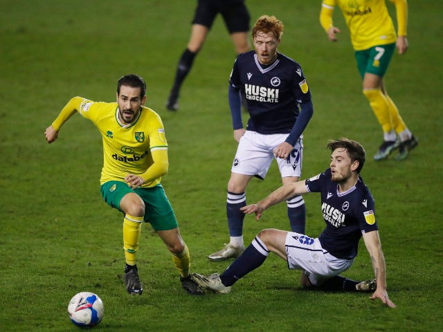 Norwich City's Mario Vrancic in action with Millwall's Ben Thompson in the Championship on February 2, 2021
