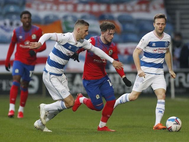 Queens Park Rangers' Dominic Ball in action with Blackburn Rovers' Harvey Elliott on February 6, 2021