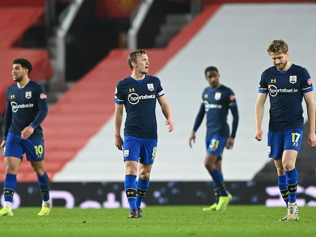 Southampton players look dejected during their 9-0 defeat to Manchester United in February 2021