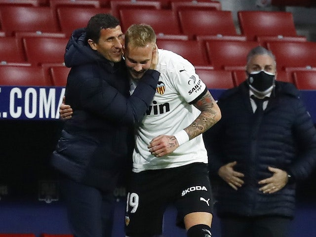 Valencia boss Javi Gracia celebrates with Uros Racic in January 2021