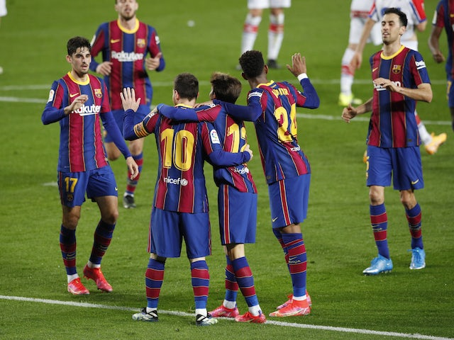 Barcelona's Lionel Messi celebrates scoring their second goal with teammates on February 13, 2021