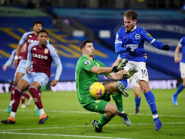 Brighton & Hove Albion's Alexis Mac Allister in action with Aston Villa's Emiliano Martinez in the Premier League on February 13, 2021