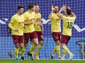 Burnley's Jay Rodriguez celebrates scoring their second goal with Ashley Westwood and teammates on February 13, 2021