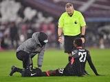 Liverpool striker Divock Origi receives treatment in January 2021