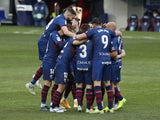 Huesca's Javi Galan celebrates scoring their first goal with teammates in February 2021