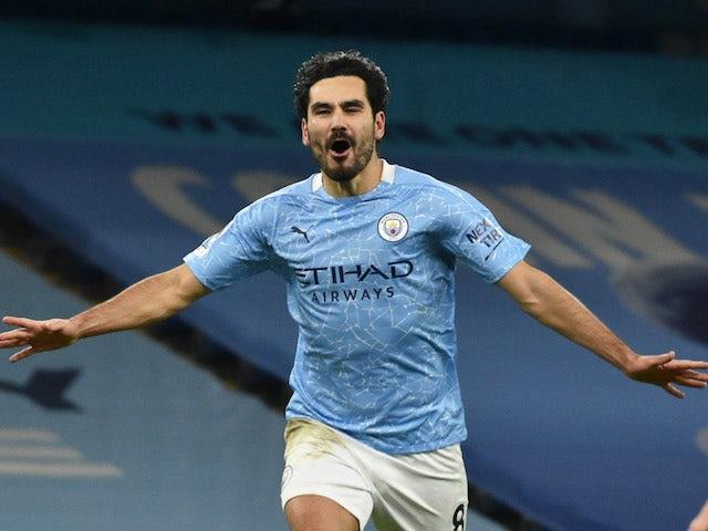 Manchester City's Ilkay Gundogan celebrates scoring their third goal on February 13, 2021