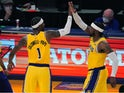 Los Angeles Lakers guard Kentavious Caldwell-Pope and guard Wesley Matthews celebrate in overtime against the Oklahoma City Thunder on February 9, 2021