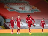 Liverpool players look dejected after conceding to Manchester City in February 2021