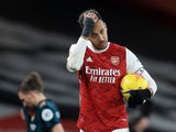 Arsenal's Pierre-Emerick Aubameyang celebrates with the match ball after scoring a hat-trick on February 14, 2021