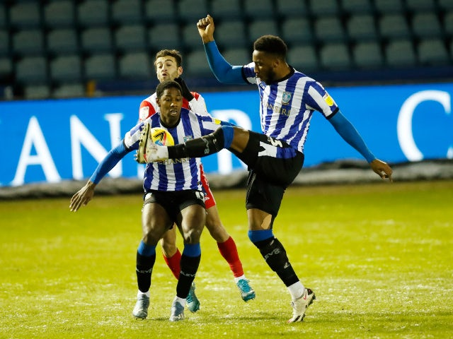 Wycombe Wanderers' Scott Kashket in action with Sheffield Wednesday's Osaze Urhoghide and Cheyenne Dunkley on February 9, 2021