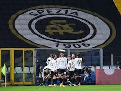 Spezia's Giulio Maggiore celebrates scoring their first goal with teammates on February 13, 2021
