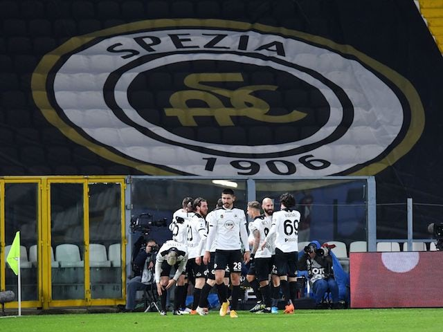Spezia's Giulio Maggiore celebrates scoring their first goal with teammates on February 13, 2021
