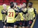 Watford's Ismaila Sarr celebrates scoring their second goal with teammates on February 13, 2021