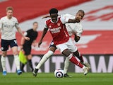 Arsenal's Bukayo Saka in action with Manchester City's Fernandinho in the Premier League on February 21, 2021