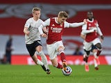 Arsenal's Martin Odegaard in action with Manchester City's Oleksandr Zinchenko in the Premier League on February 21, 2021