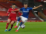 Everton's Richarlison in action with Liverpool's Ozan Kabak in the Premier League on February 20, 2021
