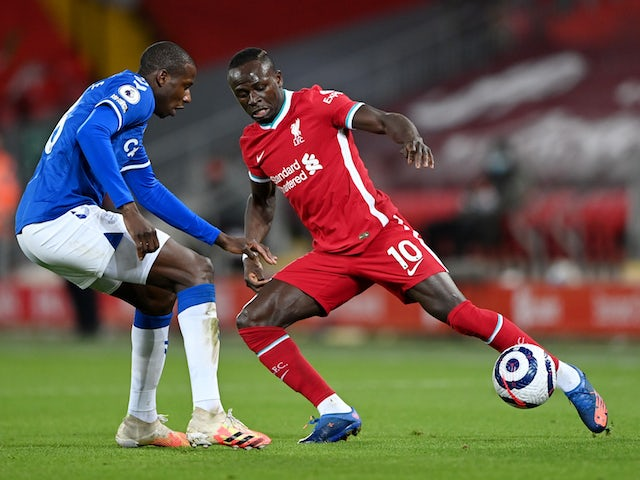 Everton's Abdoulaye Doucoure in action with Liverpool's Sadio Mane in the Premier League on February 20, 2021