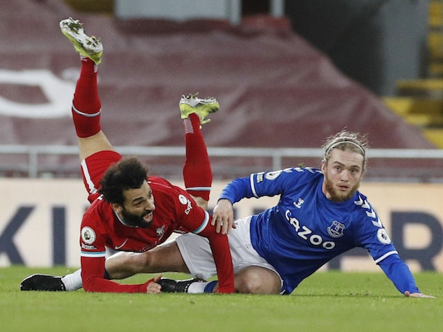 Everton's Tom Davies in action with Liverpool's Mohamed Salah in the Premier League on February 20, 2021