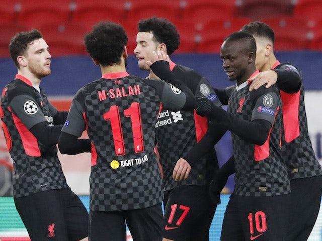 Liverpool's Sadio Mane celebrates scoring their second goal with teammates on February 16, 2021