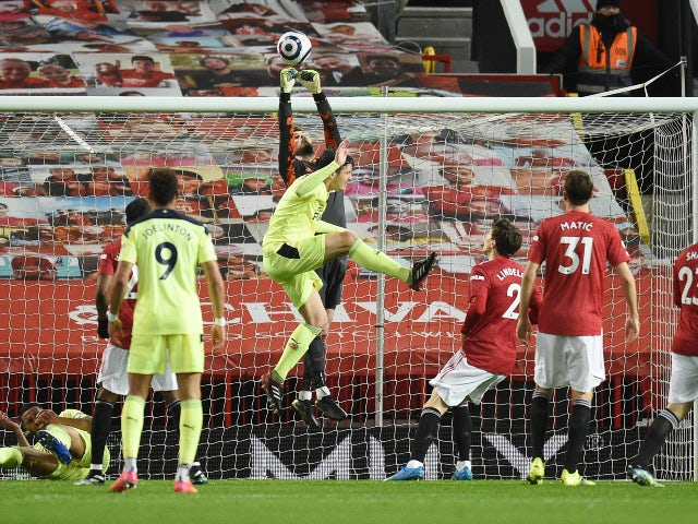 Manchester United's David De Gea saves an effort from Newcastle United's Joelinton in the Premier League on February 21, 2021