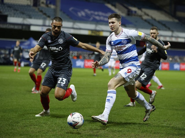 Queens Park Rangers' Lyndon Dykes in action with Brentford's Winston Reid in the Championship on February 17, 2021