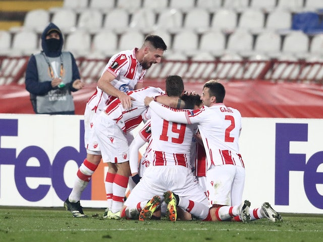 Red Star Belgrade Radovan Pankov celebrates scoring their second goal with teammates in the Europa League on February 18, 2021