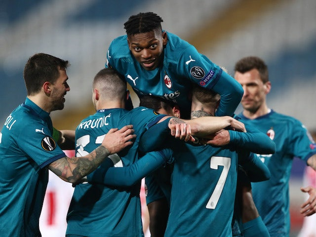 AC Milan's Theo Hernandez celebrates scoring their second goal with Rafael Leao and teammates in the Europa League on February 18, 2021