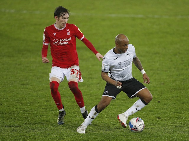 Swansea City's Andre Ayew in action with Nottingham Forest's James Garner in the Championship on February 17, 2021