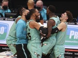Charlotte Hornets players embrace Terry Rozier after his game-winning shot against the Golden State Warriors on February 20, 2021