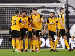 Wolverhampton Wanderers celebrate after Leeds United's Illan Meslier scores an own goal in the Premier League on February 19, 2021