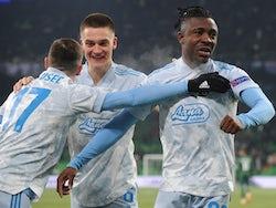 Dinamo Zagreb's Iyayi Atiemwen celebrates scoring their third goal with teammates in the Europa League on February 18, 2021