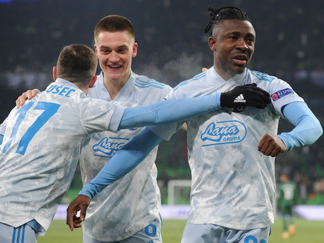 Dinamo Zagreb's Iyayi Atiemwen celebrates scoring their third goal with teammates in the Europa League on February 18, 2021