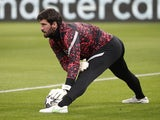 Alisson Becker warms up for Liverpool on February 16, 2021