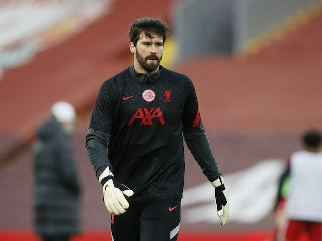 Alisson Becker warms up for Liverpool on February 20, 2021