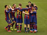 Barcelona's Ousmane Dembele celebrates scoring their first goal with teammates on February 27, 2021